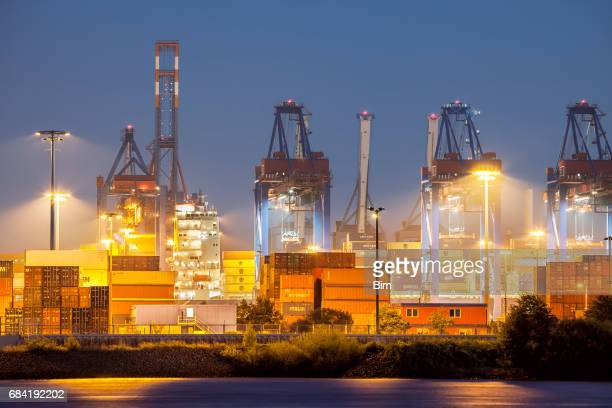 Harbor Cargo Container Terminal at Night in Hamburg, Germany
