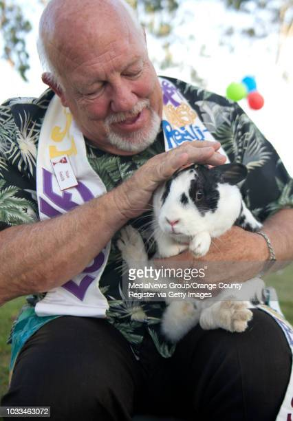 """Harbor Christian Church Pastor Stan Smith blesses patches before blessing her rabbit sister Basil, and photos of patches' late """"girlfriend"""" Clover,..."""
