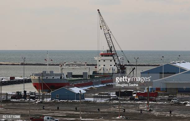 Harbor crame loads exported goods in a Freight ship