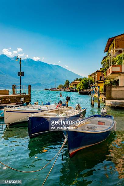 harbor of limone in italy - lake garda stock pictures, royalty-free photos & images