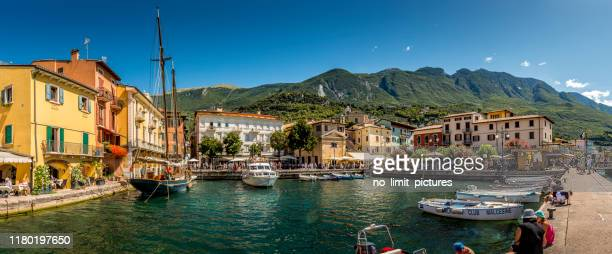 harbor of malcesine in italy - malcesine stock pictures, royalty-free photos & images