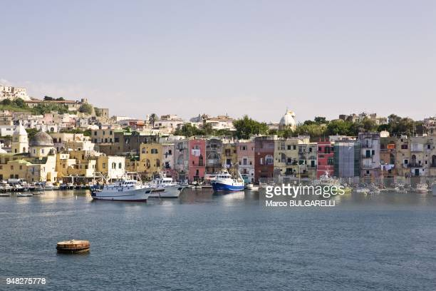 Harbor of Marina Grande with the coloured architecture in background on June 12 2012 in Procida Italy