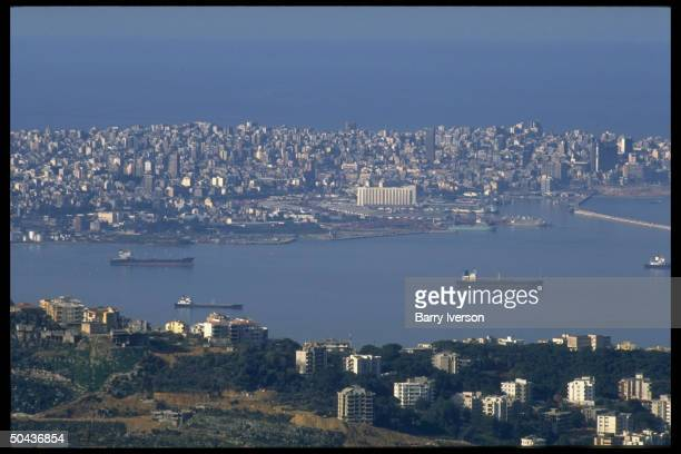 Harbor skyline of W Beirut in panorama fr mountains above on E side