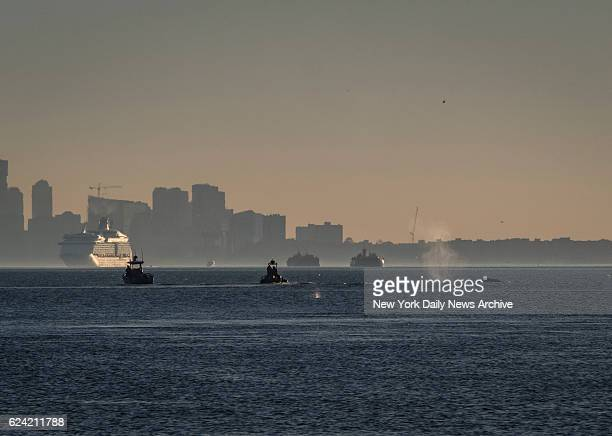 Harbor Unit boats follow what seems to be a whale heading south on the Hudson River near the George Washington Bridge in Manhattan on Wednesday...