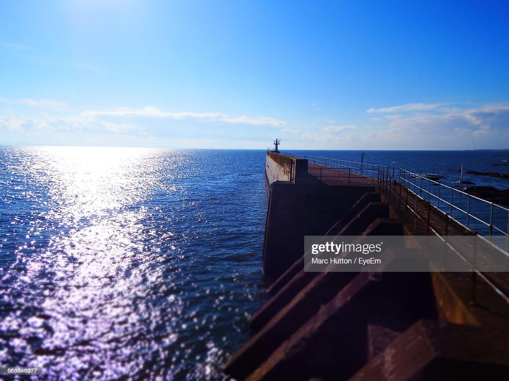 Harbor Wall Over Sea Against Sky : Stock Photo