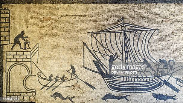 Harbor with lighthouse a boat and two transport ships with crews at work mosaic from the domus of Palazzo Diotallevi in Rimini Emilia Romagna Italy...