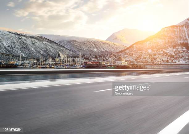 harbor with sailboats and road with blurred motion, norway - image stockfoto's en -beelden