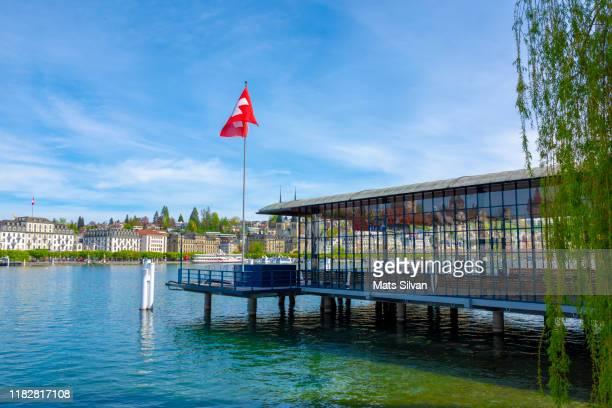 harbor with swiss flag and cityscape - ルツェルン ストックフォトと画像