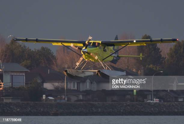 Harbour Air Pilot and CEO Greg McDougall flies the worlds first allelectric zeroemission commercial aircraft during a test flight in a de Havilland...