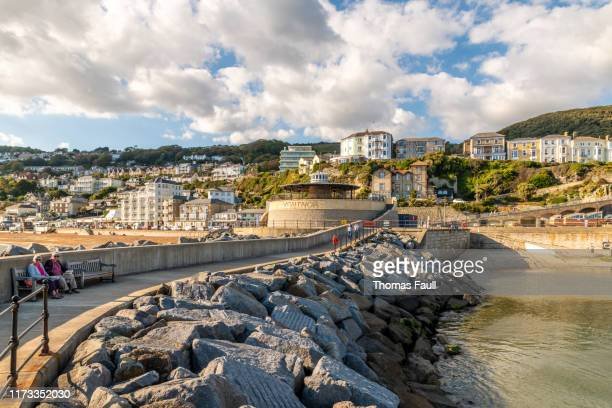 harbour defence wall and town  in ventnor, isle of wight - isle of wight stock pictures, royalty-free photos & images