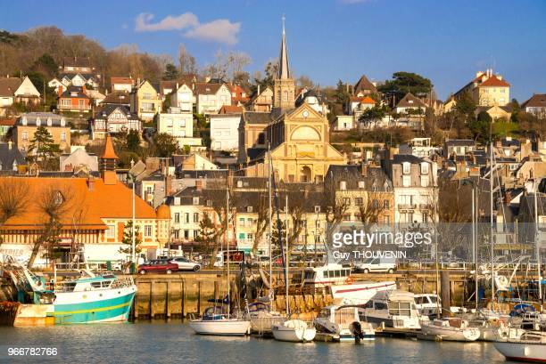 Harbour, fishing boats, town and church in the background, Trouville, Normandy, France.