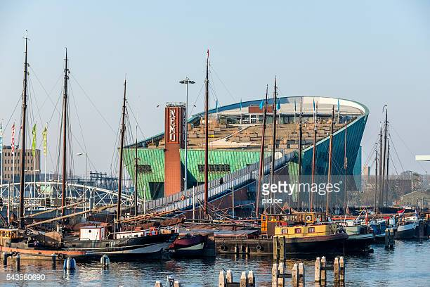 harbour of amsterdam with in the back the museum nemo - nemo museum stock pictures, royalty-free photos & images