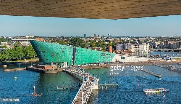 harbour of amsterdam with in the front the museum nemo - nemo museum stock pictures, royalty-free photos & images
