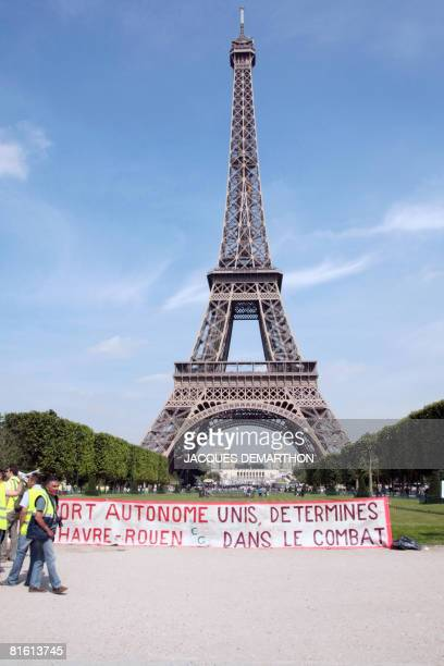 Harbour's workers lay down a banner as they demonstrate on June 18 in front of the Eiffel Tower in Paris to oppose a reform on port deregulation to...