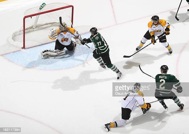 A hard backhand by Olli Maatta of the London Knights beats JP Anderson of the Sarnia Sting in an OHL game on March 1 2013 at the Budweiser Gardens in...