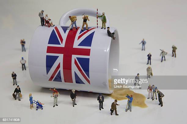 Hard Brexit soft Brexit Waiting for the decisions of the British government The photo shows an overturned coffee cup with British flag and miniature...