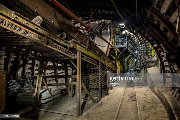 hard coal mine underground corridor with belt conveyor system and silo - silesia stock pictures, royalty-free photos & images
