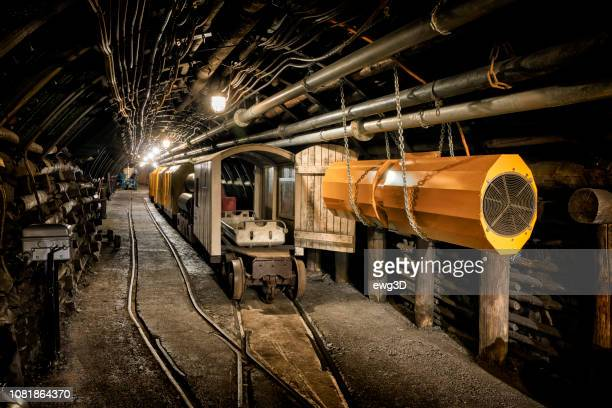 hard coal mine underground corridor with steel support system and electrical equipment - mining natural resources stock pictures, royalty-free photos & images