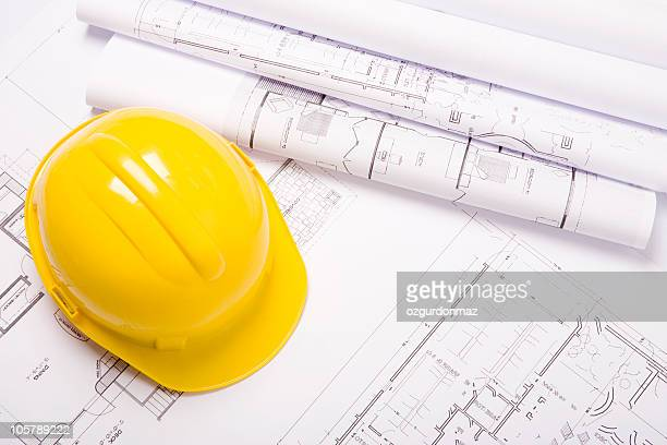 Hard hat and architectural plans