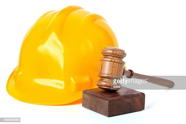 hard hat and gavel - employment law stock photos and pictures