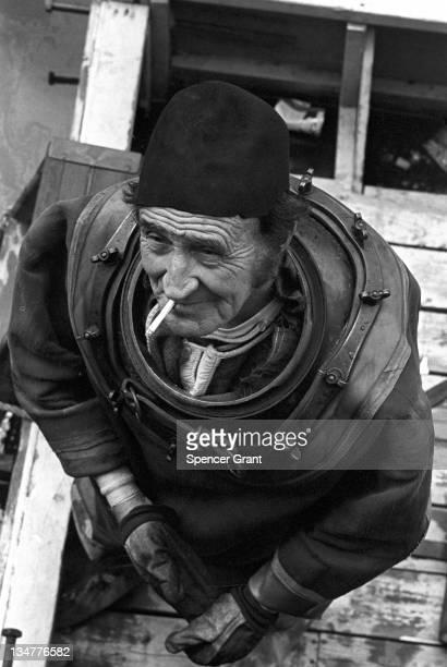 Hard hat deep sea diver Arthur Mercer at Charles River Dam Boston Massachusetts 1970