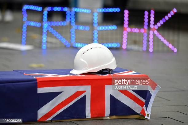 Hard hat is seen on a coffin, as protesters gather at an event organised by Justitia Hong Kong to mourn the loss of Hong Kong's political freedoms,...