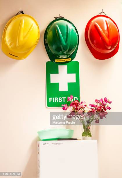 hard hats and a first aid box - medicine cabinet stock pictures, royalty-free photos & images