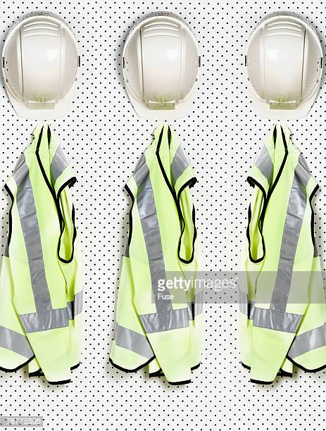 hard hats and safety vests - waistcoat stock pictures, royalty-free photos & images