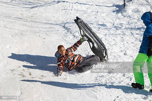 Hard landing at slope in Long Meadow. Brooklynites gathered in droves at Prospect Park to celebrate the close of one of NYC's largest blizzards by...