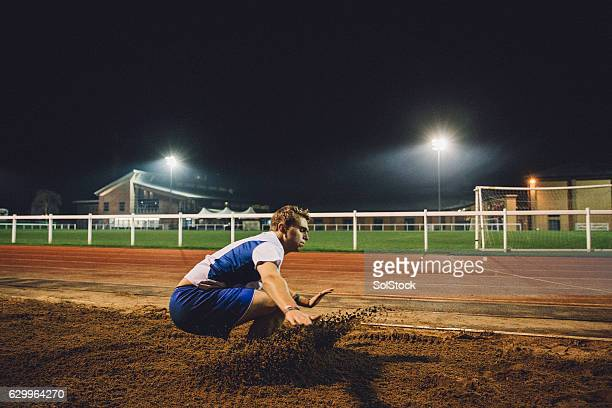 hard landing - long jump stock pictures, royalty-free photos & images
