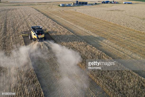 Hard red winter wheat is harvested with a CNH Industrial New Holland combine harvester in this aerial photograph taken above Plainville Kansas US on...