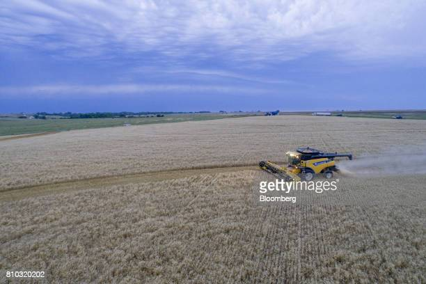 Hard red winter wheat is harvested with a CNH Industrial New Holland combine harvester in this aerial photograph taken above Zurich Kansas US on...