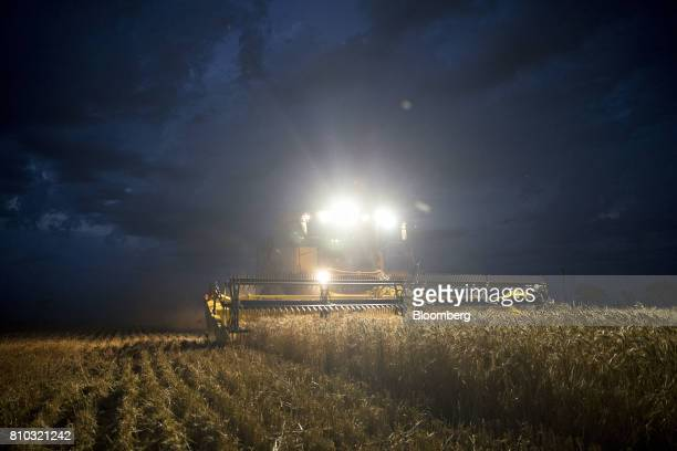 Hard red winter wheat is harvested with a CNH Industrial New Holland combine harvester in Plainville Kansas US on Wednesday June 28 2017 Spring wheat...