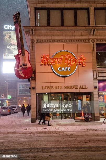 Hard Rock Cafe at Dundas Square, Toronto. There is a big red guitar beside the signage. Hard Rock Cafe International, Inc. Is a chain of theme...