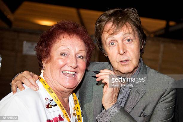 Hard Rock Cafe's cultural attache and original Hard Rock waitress Rita Gilligan poses with her old friend Sir Paul McCartney backstage on day 2 of...