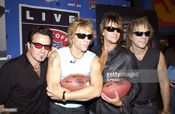 Hard rock group Bon Jovi hold a press conference during NFL Kickoff Weekend at the Marriot Marquis hotel in Times Square on September 5 2002 in New...