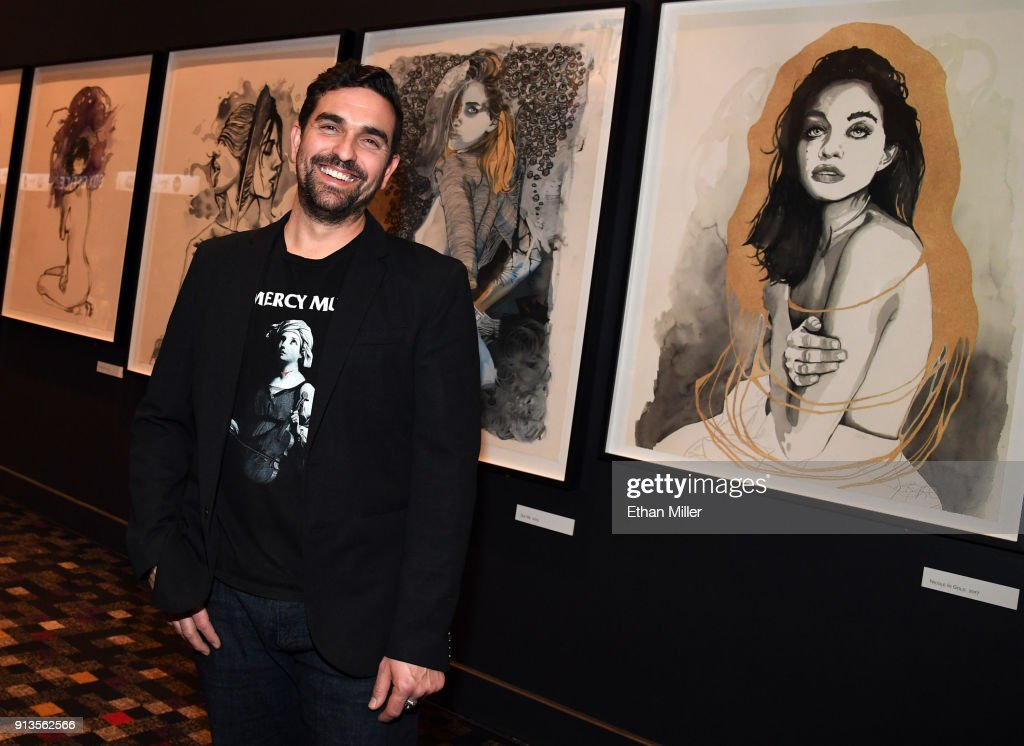 Hard Rock Hotel & Casino curator Beau Dobney poses in front of a display of fine art giclee prints by singer Brandon Boyd of Incubus outside The Joint inside the Hard Rock Hotel & Casino ahead of the first night of the band's four-show limited engagement on February 2, 2018 in Las Vegas, Nevada.