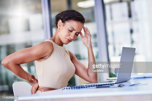 hard work comes at a price - bad posture stock pictures, royalty-free photos & images