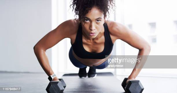 hard work gets hard muscles - plank position stock pictures, royalty-free photos & images