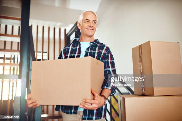 hard work got him the home of his dreams - carrying stock pictures, royalty-free photos & images