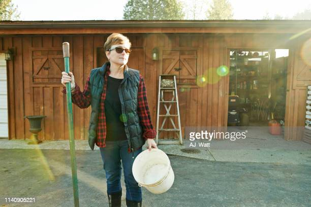 hard work grows a thriving farm - daily bucket stock pictures, royalty-free photos & images