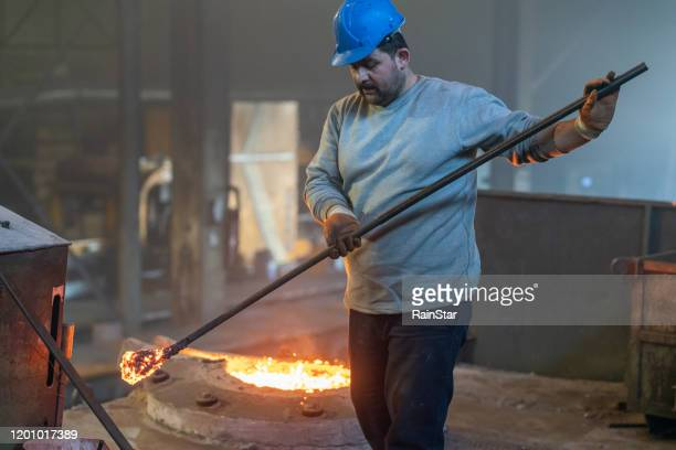 hard work in the foundry - iron filings stock pictures, royalty-free photos & images
