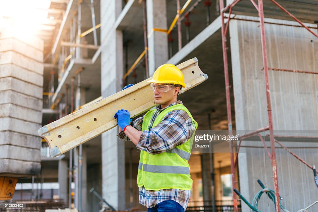 Hard working construction worker : Stock Photo