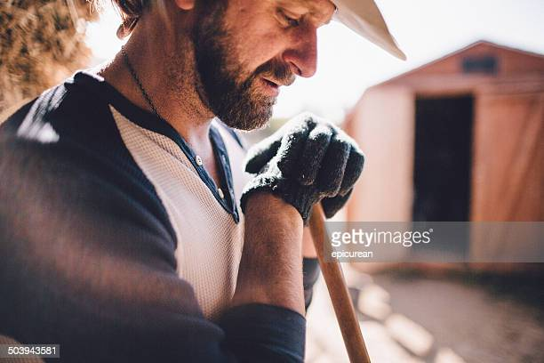hard working man takes break from manual labor - ruffled stock pictures, royalty-free photos & images