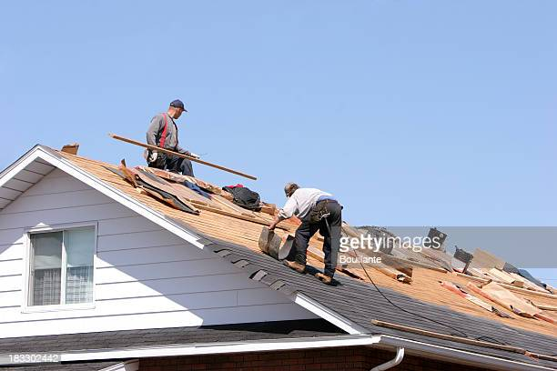 Hard working men on roof