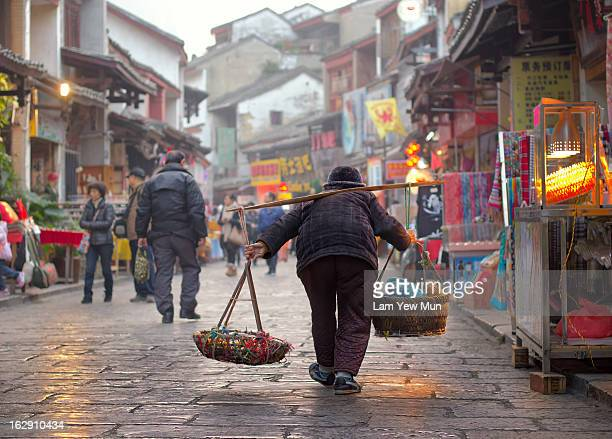 Hard working old forks is a common sight in Guangxi, China.