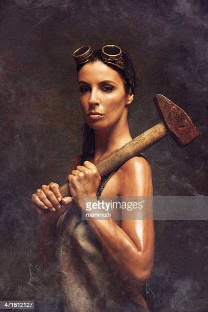 hard working woman holding a big hammer