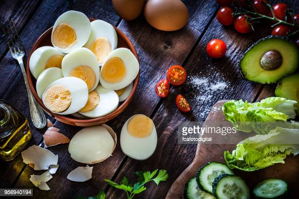 hard-boiled eggs - hard boiled eggs stock photos and pictures