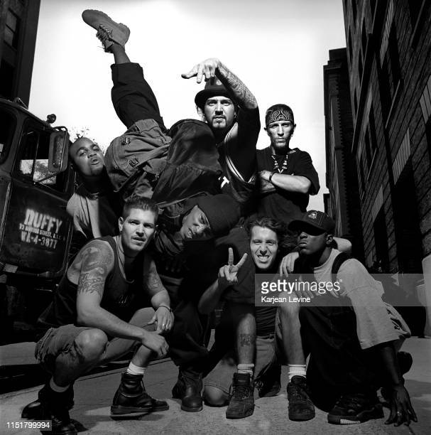 Hardcore band Biohazard pose with members of hip-hop group Onyx on a Greenwich Village street on August 13, 1993 in New York City, New York following...