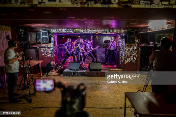 Hardcore musicians perform for live-stream cameras in front of an empty dance floor during the lockdown on January 29, 2020 in Prague, Czech...